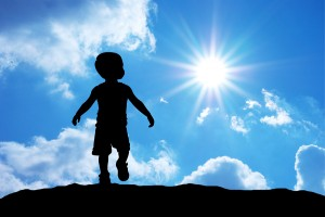 Baby silhouette on sky background.